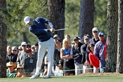 Jordan Spieth hits on the first fairway during the first round of the Masters golf tournament Thursday in Augusta, Ga.