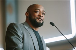 Steelers coach Mike Tomlin talks to a group of athletic directors and coaches from the WPIAL and City League about concussions Thursday at Heinz Field.
