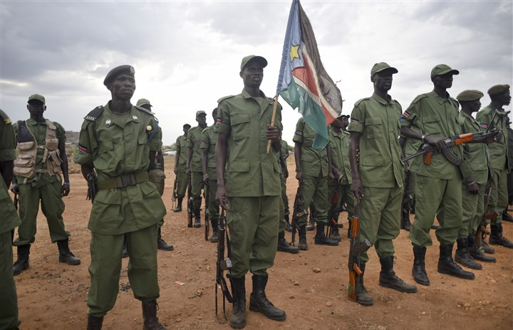 South Sudan Rebels Return-3 South Sudanese rebel soldiers stand to attention at a military camp in the capital Juba, South Sudan, April 7.