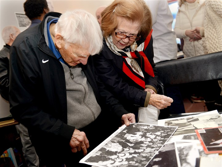 20160409ppWardReunion2SUNLOC-6 Steelers chairman Dan Rooney and his wife Patricia look over an old Hope Harveys' team photograph at the reunion of the Hope Harveys Football Club.