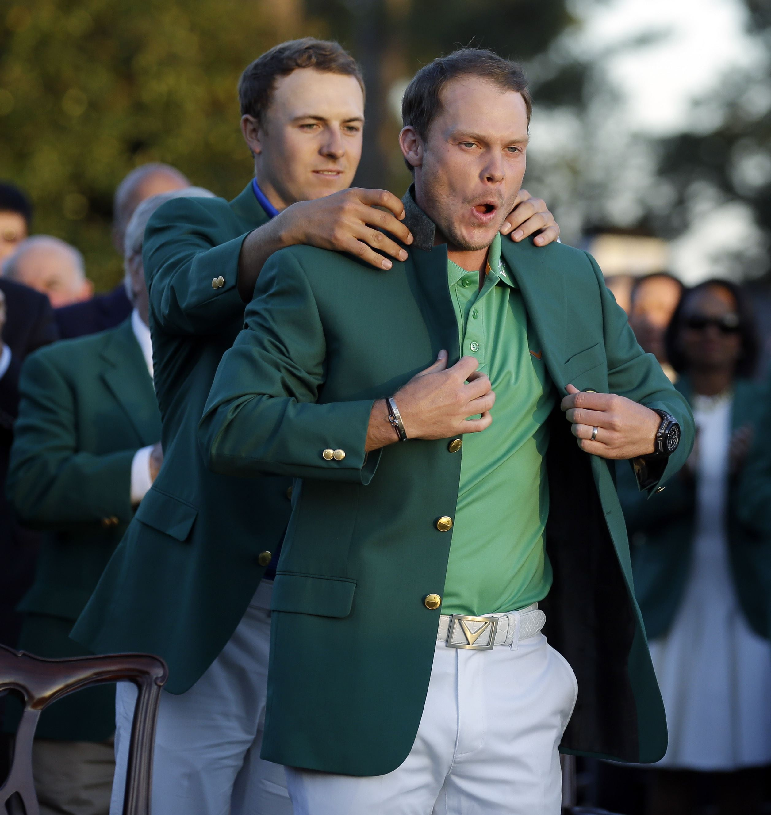Englishman Willett dons green jacket after Spieth collapses