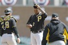 Pirates pitching coach Ray Searage, right, and catcher Francisco Cervelli (29) walk to the mound for a conversation with pitcher Juan Nicasio.