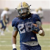 Chawntez Moss carries during Pitt's spring camp.