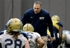 Pitt head coach Pat Narduzzi talks to players as they warm up during spring camp Tuesday on the South Side.