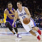 The 76ers' T.J. McConnell drives past Lakers guard D'Angelo Russell in a game earlier this season at Wells Fargo Center in Philadelphia.