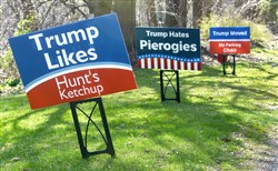 Eric Rickin posted humorous anti-Donald Trump campaign signs in his yard, shown here on Tuesday.