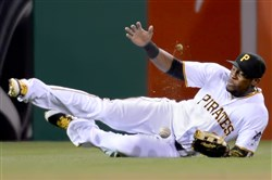 Starling Marte can't come up with a ball hit by the Tigers' Ian Kinsler in the sixth inning Wednesday night at PNC Park.