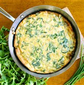 Spaghetti Frittata with Arugula and Fresh Herbs.