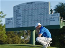 Jordan Spieth gathers his thoughts on the 18th green in front of the leaderboard before finishing his final round of the Masters at Augusta National Golf Club on April 10.