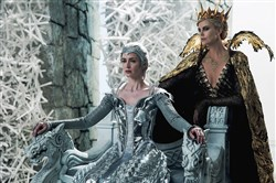 "From left, wicked sisters Freya (Emily Blunt) and Queen Ravenna (Charlize Theron) threaten the enchanted land with twice the darkest force it's ever seen in the epic action-adventure ""The Huntsman: Winter's War."""