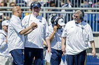 Penn State football coach James Franklin, left, talks with offensive coordinator Joe Moorhead and offensive line coach Matt Limegrover, right, during the Blue-White Game in April.