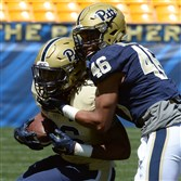 Pitt's Rimoni Dorsey takes down Chawntez Moss in the Blue-Gold spring game Saturday at Heinz Field.