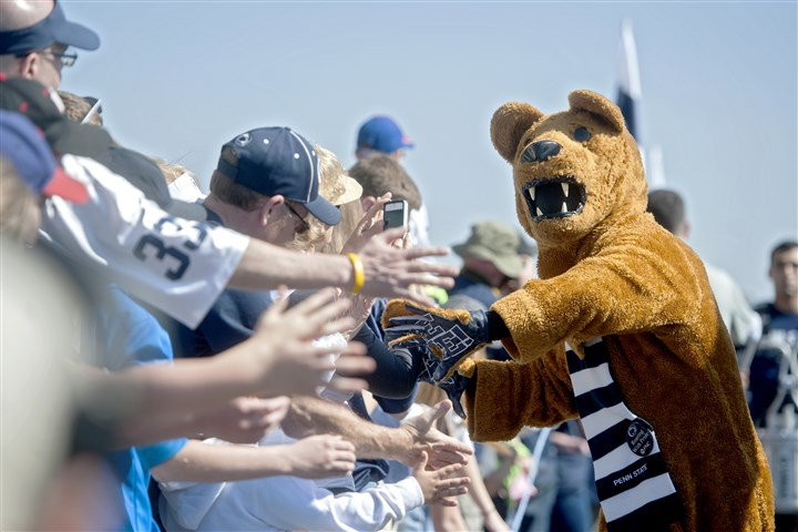 Penn State Spring Football-1 The Penn State Nittany Lion mascot high-fives fans as the team arrives at Beaver Stadium for the Blue-White spring NCAA college football game.