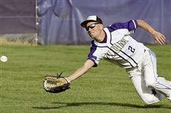 Plum's Taylor Vivino makes a diving catch earlier this season against Franklin Regional.