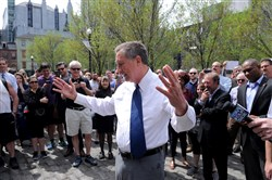 Republican presidential candidate and Ohio Gov. John Kasich talks to supporters in Market Square on Tuesday.