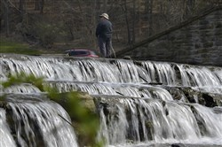 "John McKean of Shaler Twps. ""jig fishes"" in the Marshall Lake near the falls in North Park."