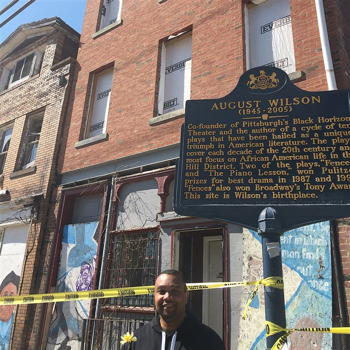 Paul Ellis, August Wilson's nephew Paul Ellis, August Wilson's nephew and executive director of the August Wilson House board, at 1727 Bedford Ave., next to the landmark plaque and in front of the fresh brick and steel beam installed in 2014.