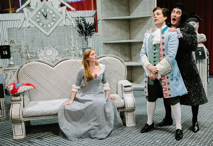 "20160418-Opera03-2 Layla Claire, as Anne Trulove, Alek Shrader, as Tom Rakewell, and David Pittsinger, as Nick Shadow, pose for a photo on the set of Stravinsky's opera, ""The Rake's Progress"" at Pittsburgh Opera's headquarters in the Strip District on April 18."