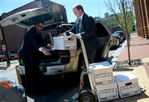 Detectives from the Allegheny County district attorney's office load files into a vehicle on April 20 after removing them from the offices of the Intergovernmental Cooperation Authority, Downtown.