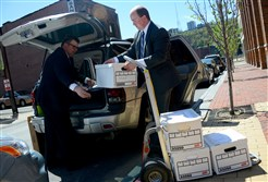 Detectives from the Allegheny County district attorney's office load files to a vehicle after removing them from the offices of the Intergovernmental Cooperation Authority in Downtown Pittsburgh last month, as part of the DA's investigation in the ICA's financial records.