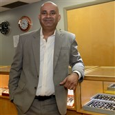 Brilliant Nuevo Diamonds owner Navin Bhambhwani in his store in the Clark Building on Liberty Avenue, Downtown.