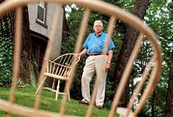 George Trent was also a woodworker. In this photo from the 1990s, he is shown with some of his hand-made Windsor chairs in the yard of his Ben Avon home.