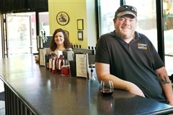 John and Angela Burgess, owners of Washington Winery/A&M Wine and Beer Supplies at the corner of South Main and Maiden streets.