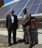 John Camillus and the Rev. John Wallace at the new solar greenhouse at the Bible Center Church in Homewood.