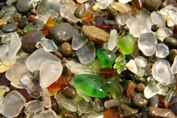 Raw beach glass is made from glass bottles and other items that were lost in a lake or an ocean, broken and naturally tumbled by the sand and waves.