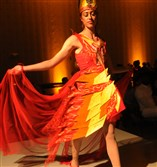 A model shows off a fiery ensemble at the 2016 Ecolution Fashion Show. The event returns for its third year on April 20 at the Fairmont Pittsburgh, Downtown.