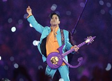 Prince performs in 2007 during the halftime show at the Super Bowl XLI at Dolphin Stadium in Miami.