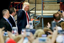 Republican presidential candidate Donald Trump arrives at a rally Thursday at the Pennsylvania Farm Show Complex and Expo Center in Harrisburg.