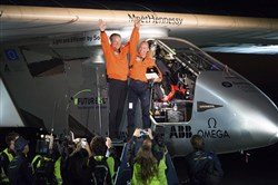 SOLAR success Solar Impulse 2 pilots Bertrand Piccard, right, and Andre Borschberg celebrate after their solar-powered plane landed Saturday evening at Moffett Field in Mountain View, Calif., completing a risky, three-day flight across the Pacific Ocean as part of its journey around the world.
