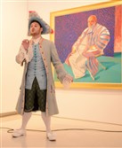 "Adam Bonanni, dressed as Tom Rakewell, performs an aria from Stravinsky's ""The Rake's Progress,"" during a Third Thursday event at the Carnegie Museum of Art on April 21. The opera singers performed in front of a painting by British artist David Hockney, who designed the sets, costumes, wigs and props. Pittsburgh Opera's production of ""The Rake's Progress"" opens Saturday at the Benedum Center."