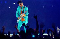 Prince performs in the halftime show at Super Bowl XLI in Miami Gardens, Fla., in 2007.