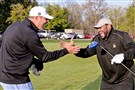 Steelers quarterback Ben Roethlisberber greets former running back Jerome Bettis on the practice range at Oakmont Country Club Monday morning. The two were taking part in 'Celebration of Champions' as part of media day at the site of the U.S. Open.