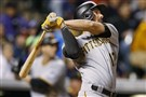 The Pirates' Matt Joyce follows the flight of his three-run home run off Colorado Rockies relief pitcher Scott Oberg in the seventh inning Monday.