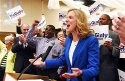 Katie McGinty talks to supporters following her victory in the Democratic primary for U.S. Senate. U.S. Sen. Bob Casey is at far left.