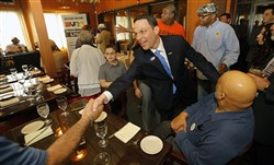 Montgomery County Commissioner Josh Shapiro, who secured the Democratic nomination for state attorney general, shakes hands with a voter at a diner in Pennsylvania on Tuesday.