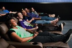 Employees try out the new seats at Century Square Luxury Cinemas in West Mifflin.