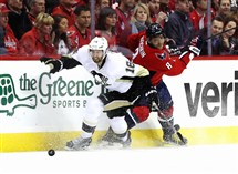 The Penguins' Eric Fehr and Capitals' Alex Ovechkin go after the puck in the first period of Thursday night's playoff game.