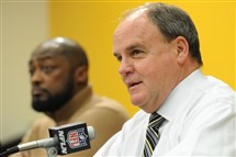 Coach Mike Tomlin listens as Steelers general manager Kevin Colbert discusses the team's 2016 draft picks. Colbert, who joined the Steelers in 2000 as director of football operations, is in his sixth year as the GM.