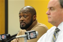 Steelers head coach Mike Tomlin discusses the team's first round draft pick Artie Burns next to general manager Kevin Colbert Thursday night at the team's South Side facility.
