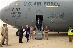 Vice President Joe Biden is greeted by U.S. Ambassador Stuart Jones on Thursday after stepping off a C-17 military transport plane upon his arrival in Baghdad.