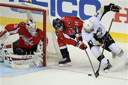 Pittsburgh Penguins Bryan Rust battles for loose puck against the Capitals at the Verizon Center Washington DC.