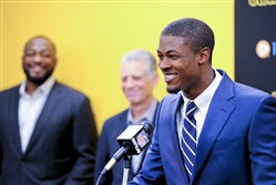 Steelers first round draft pick Artie Burns addresses the media with head coach Mike Tomlin and team president Art Rooney II behind him, during a press conference.