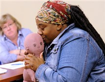 Ngozi Doreen D. Tibbs, a childbirth-breast-feeding educator talks with nurses at Magee-Women's Hospital of UPMC about ways to teach new mothers how to breast-feed.