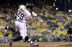 Pirates' Francisco Cervelli hits a single scoring David Freese in the fifth inning against the Reds Saturday night at PNC Park.