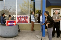 Voters wait in line at a polling station  during primary elections March 1 in Austin, Texas.