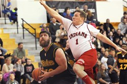 Dave Barkovich goes up for a block against Steelers offense tackle Matt Feiler during a charity basketball game in April at North Hills Middle School.